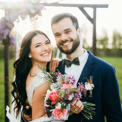 Bride and Groom holding Flowers