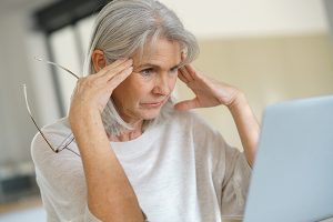 Retired woman looking at computer