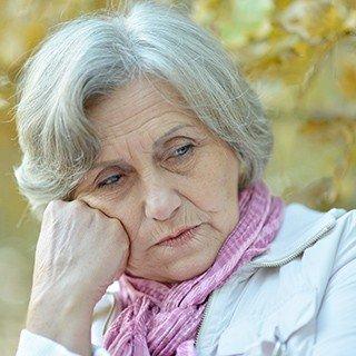 Senior looking sad