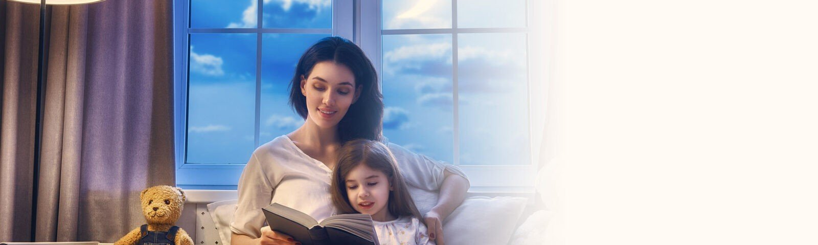 Mother reading story to child